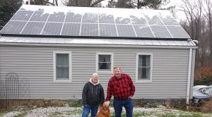 Co-op members Bill and Carol Reuther in front of their new solar system