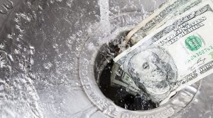 Money being washed down garbade disposal