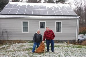 Carol and Bill Reuther in front of their solar system