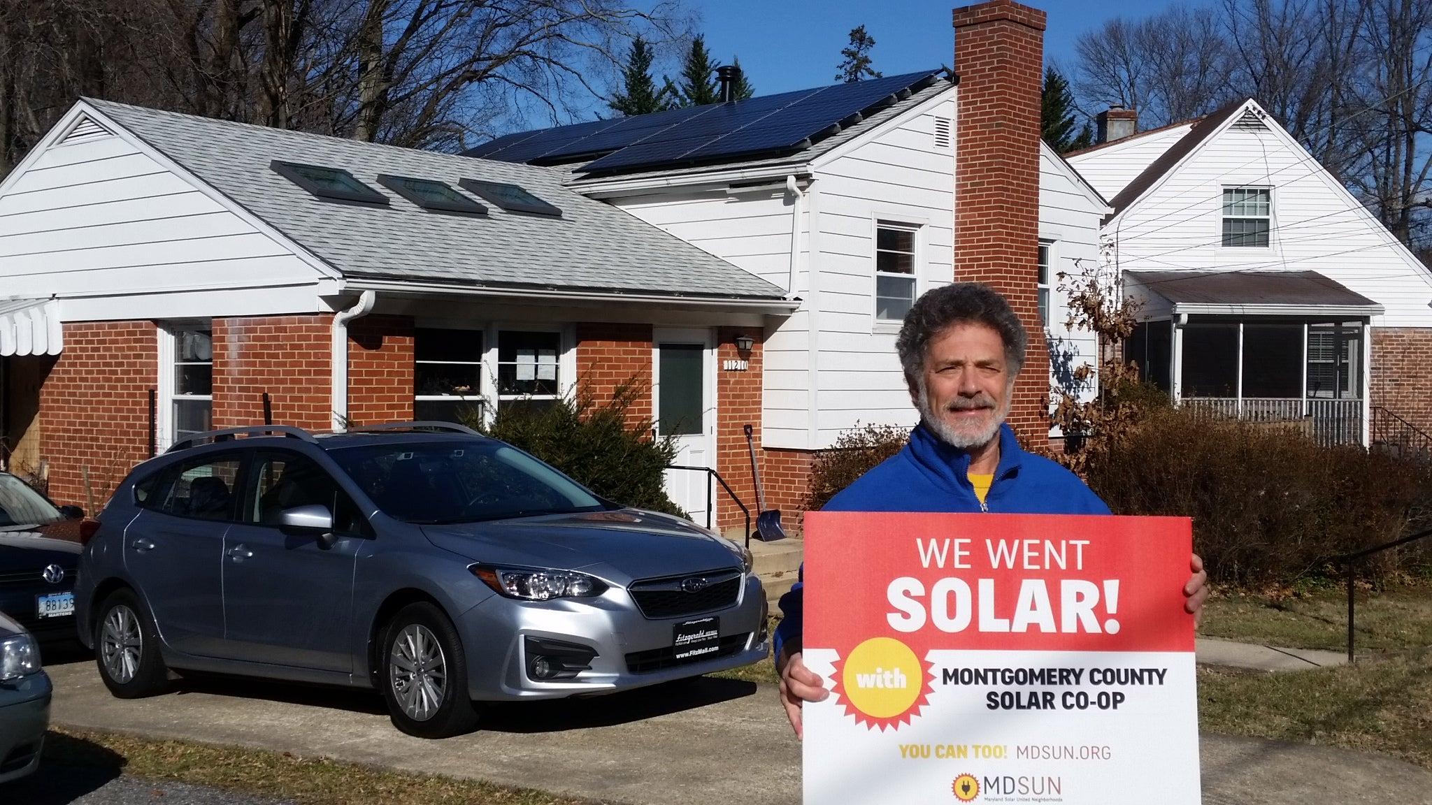 Louis Tenenbaum with his solar installation