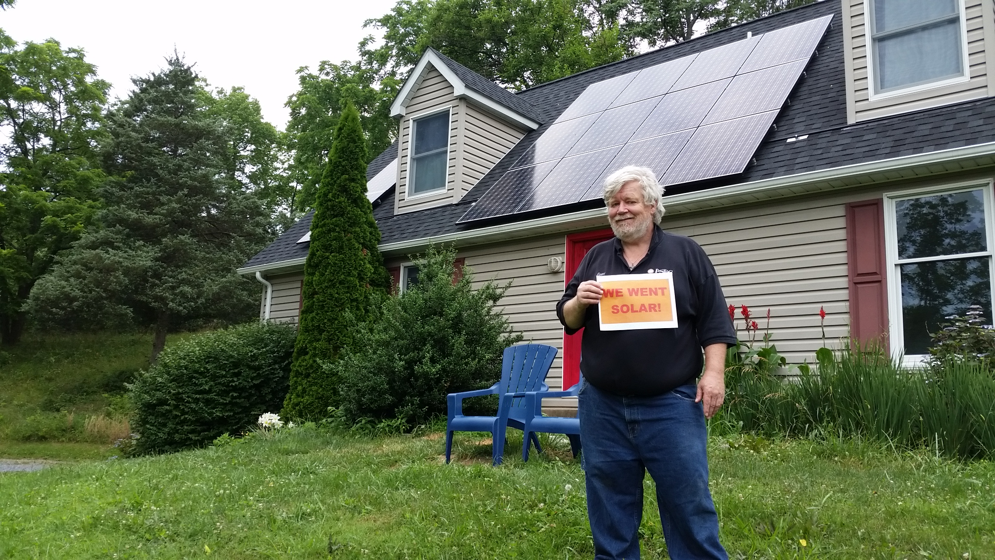 Thom Boone with his solar installation