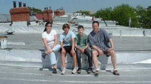 Anya and family on Mt. Pleasant roof top-min