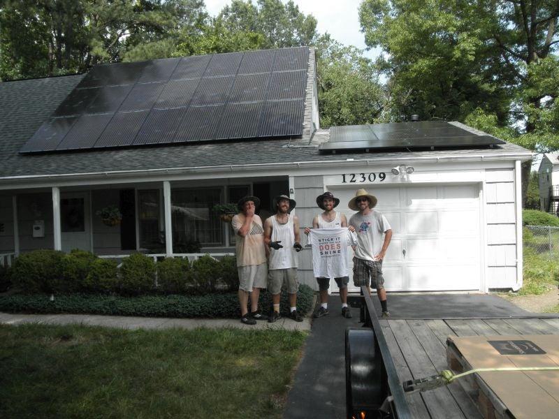 Installation crew with solar array