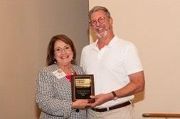 Orlando Mayor Jacobs awards Michael Cohen for his solar co-op work.