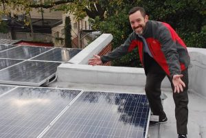 Co-op member proudly displays rooftop solar array