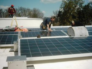 Solar panels being installed on a commercial building in Washington, D.C.
