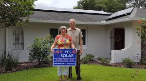 Florida Co-op members with Vote Yes 4 Solar Sign