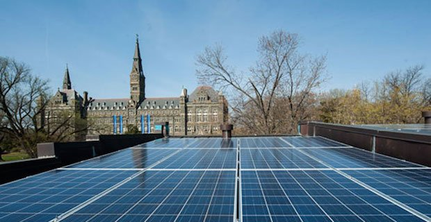 Solar panels sit atop Georgetown University campus roof.