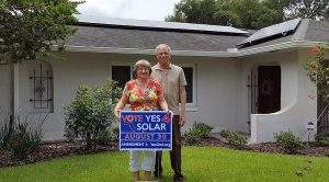 The Haddads in front of their new solar home