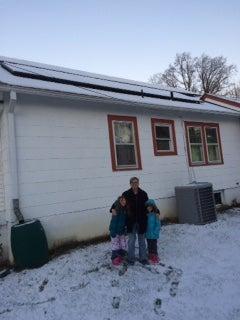 The Schneider Family with their solar installation