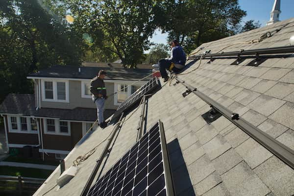 Solar installation on asphalt shingle roof