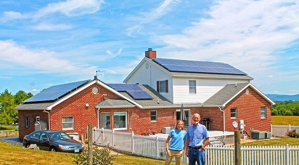 The Shanks in front of their new 12.72 kW system