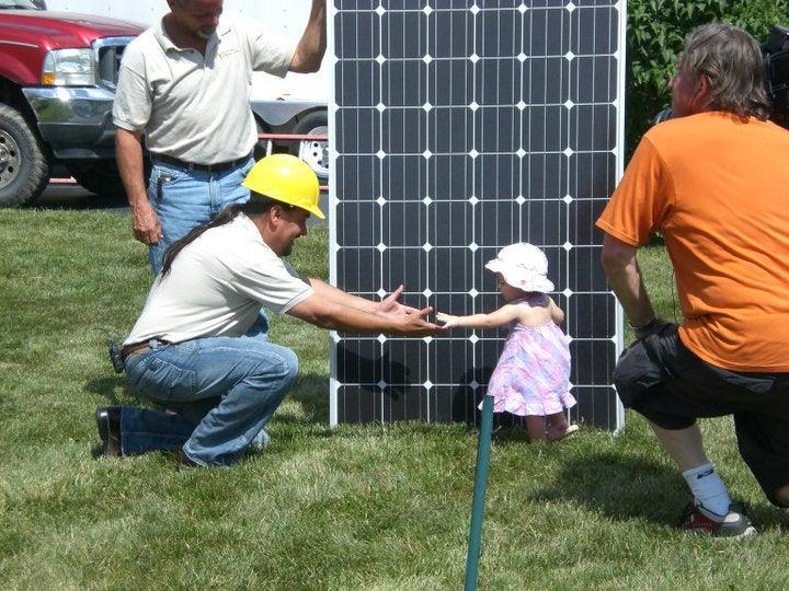 Mountain View Solar baby reaching for solar installer