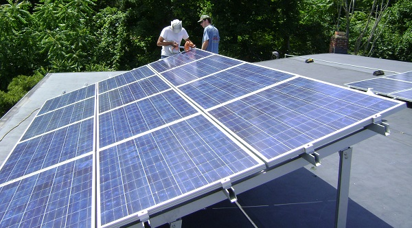 Installers work on a rooftop solar array in Nevada