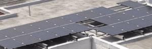 Parapet solar installation on flat roof