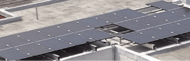 Parapet solar installation on flat roof