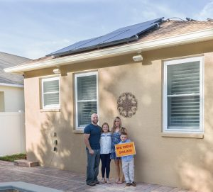 Florida co-op members showing off their solar system