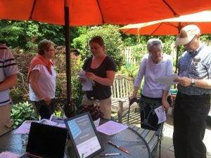 SUN Community Event Participants Under an Umbrella