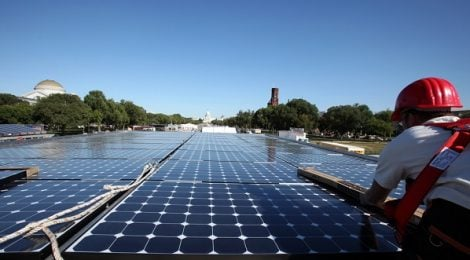 """When Georgetown University students return to classes this fall, their campus will be home to six new solar installations, totaling 1.1 MW. Together, the panels will produce 1.5 million kilowatt-hours of power, enough to save the University $3 million over the next 20 years. These types of projects are becoming routine as the cost of solar drops and institutions see solar as a smart way to reduce their energy costs. What sets this project apart from others is that it will serve to benefit more than just the University. The project came together with the help of Root + Branch, a certified benefit corporation. The company works to support projects that create what it calls 'shared value'. Specifically, it works to harness the market in a way to benefit neighborhoods facing gentrification. """"It's clear that [solar project] developers have multiple streams of revenue, the sale of power and SRECs (solar renewable energy credits),"""" said Laura Recchie, Root + Branch President. """"We looked at that and asked how do we create winners from that?"""" Root + Branch answered the question by creating a """"community investment fund"""" using a portion of the sale of the SRECs the system will generate. SRECs represent the """"green"""" value of the electricity generated from solar and can be sold on a market like a stock in a company. Utilities buy SRECs to comply with renewable energy goals set by the states where they operate. SRECs offer an additional revenue stream to help renewable energy pay for itself. The fund is expected to generate hundreds of thousands of dollars. This money will be used for creating low-income access to solar. Recchie said Root + Branch will be working with Georgetown faculty and students to determine how the funds are distributed. """"D.C.'s solar-friendly policies are one of the main reasons we were able to attract a developer to work with us,"""" Recchie said. 'The project I am describing would not be able to be done elsewhere."""" This is due to the District's strong market """