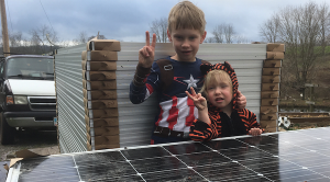 The Wedel children with their solar panels