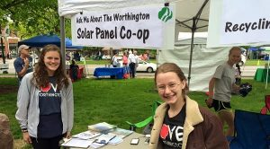 Olivia, (right) tells her neighbors about the Worthington co-op at Green on the Green