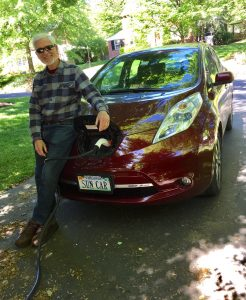 Potomac Solar Co-op member, Charles Kleymeyer, charges his electric vehicle, SUN CAR.