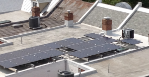 A flat roof-mounted solar array in D.C.