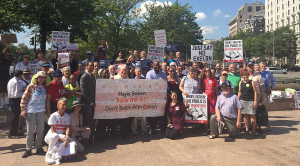 Activists at a rally against the Exelon Pepco merger