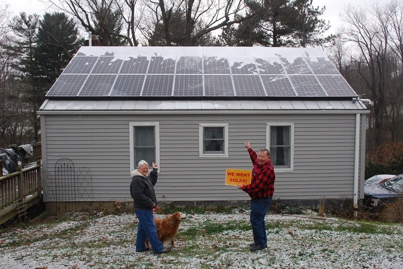 Bill and Carol Reuther point to their new solar installation