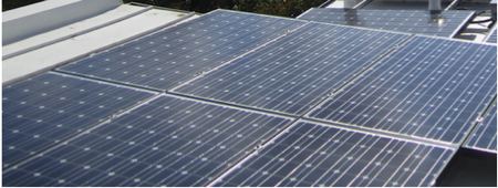 Rooftop solar installation including standing seam clamp and rails