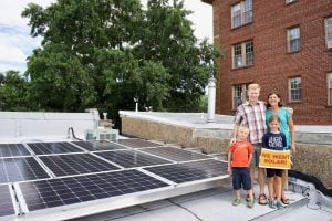 Family in Washington, D.C. with their solar system