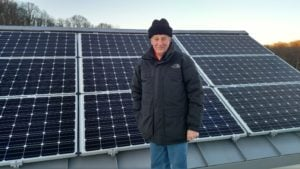 Solar homeonwer on roof with system.