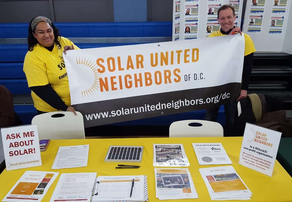 Solar United Neighbors of D.C. Program Director Yesenia Rivera and VP of Go Solar Programs Corey Ramsden welcomed community members at the Health & Community Fair following the 37th Annual Dr. Martin Luther King, Jr. Parade in Anacostia.