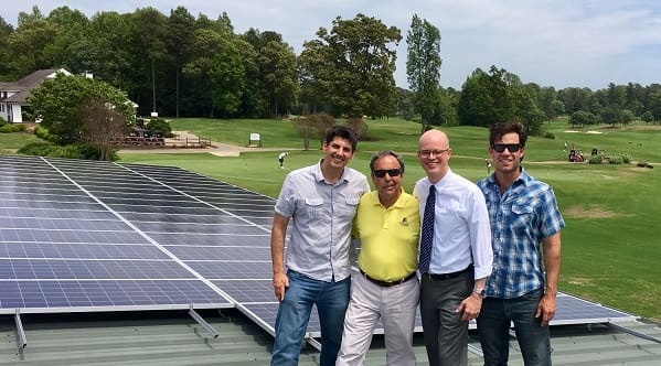Kiskiack Golf Club became the first golf course in Virginia to go solar in May 2018. (L to R): Solar United Neighbors of Virginia Program Director Aaron Sutch, Kiskiack owner Carl Zangardi, William & Mary's Henry R. Broaddus, and Chad Wilkins from Convert Solar.