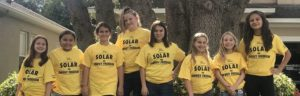 The first girl scout troop to earn their SUN patches, Troop 32512 from Tampa, FL, poses with their Solar United Neighbors shirts.