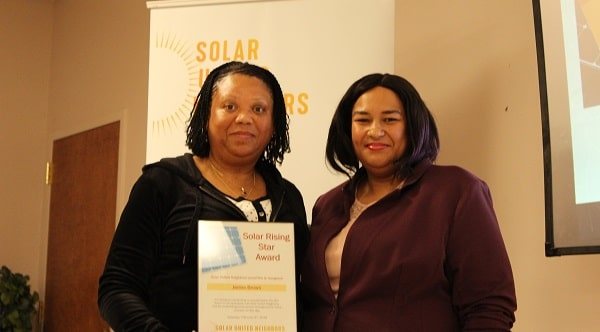 Solar for All participant Jackie Brown receives a Rising Solar Star Award.