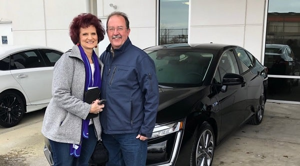 Richard and Marvina Steiner with their latest EV, a 2018 Honda clarity plug-in hybrid.