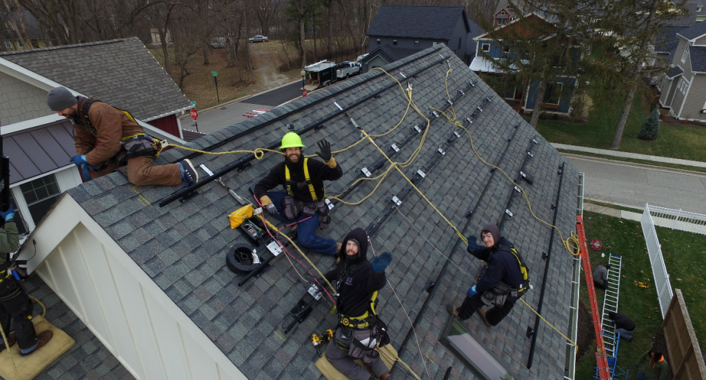 solar installers on rooftop
