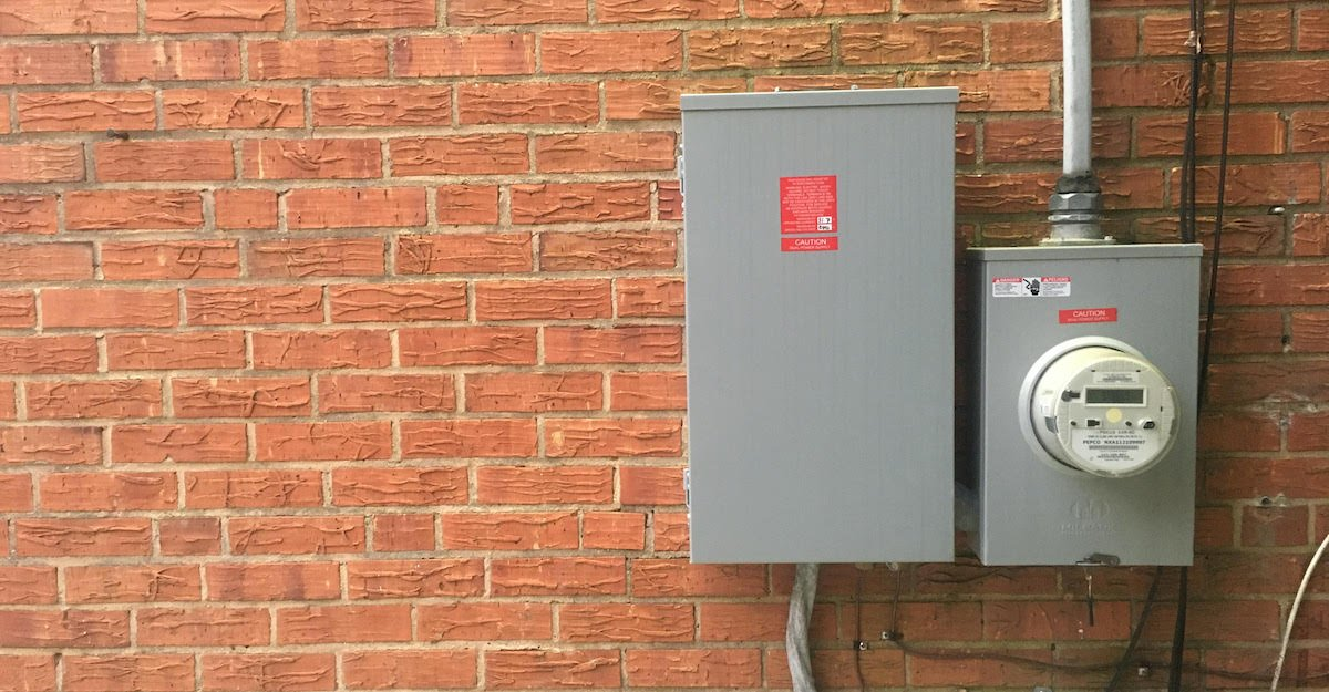 electric meter on brick wall